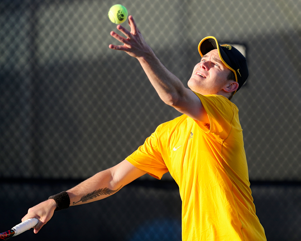 Iowa's Jonas Larsen serves during his match again Michigan State at the Hawkeye Tennis and Recreation Complex in Iowa City on Friday, Apr. 19, 2019. (Stephen Mally/hawkeyesports.com)