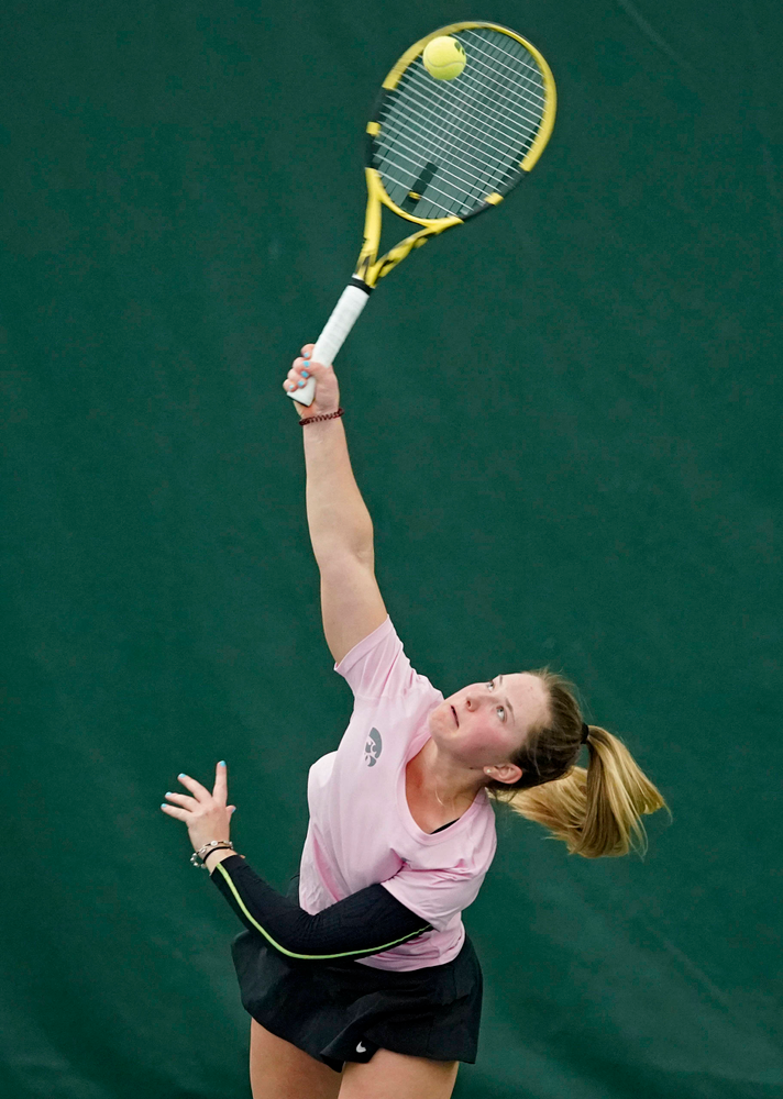 Iowa's Danielle Burich serves during her match against Purdue at the Hawkeye Tennis and Recreation Complex in Iowa City on Friday, Mar. 29, 2019. (Stephen Mally/hawkeyesports.com)