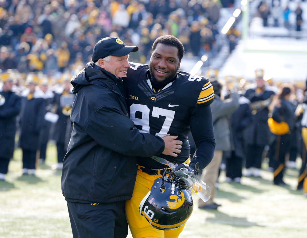 Iowa Hawkeyes defensive lineman Darian Cooper (97) hugs defensive line coach Reese Morgan during senior day activities before their game against the Purdue Boilermakers Saturday, November 21, 2015 at Kinnick Stadium. (Brian Ray/hawkeyesports.com)