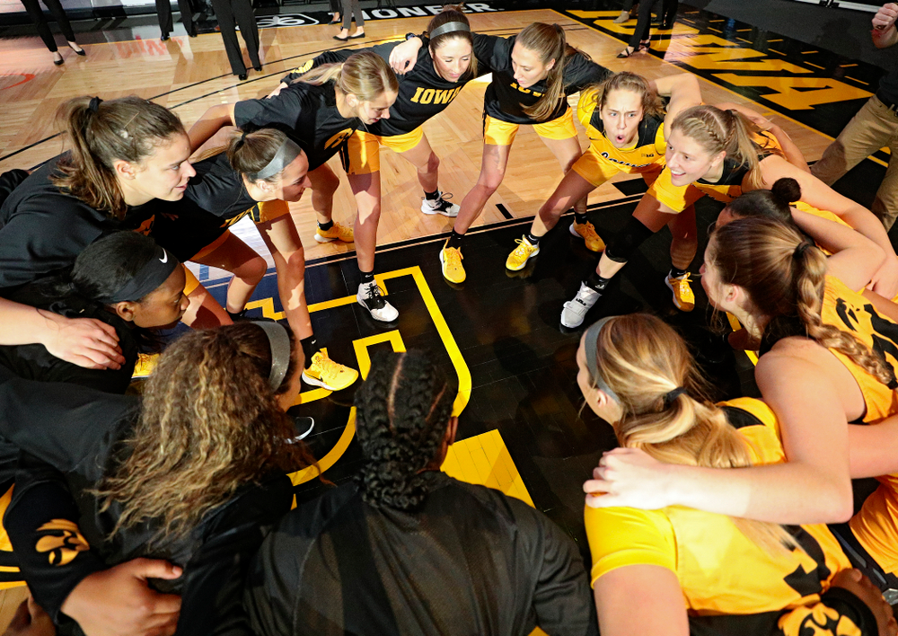 The Hawkeyes huddle before their game against Winona State at Carver-Hawkeye Arena in Iowa City on Sunday, Nov 3, 2019. (Stephen Mally/hawkeyesports.com)