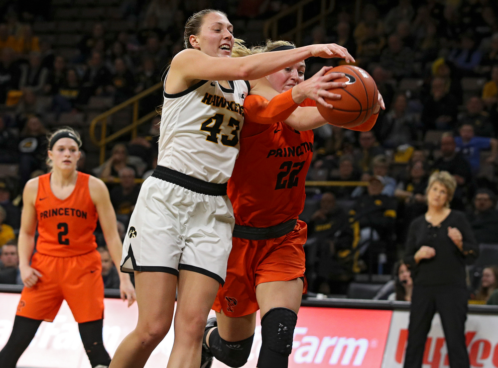 Iowa forward Amanda Ollinger (43) battles for a rebound during the fourth quarter of their overtime win against Princeton at Carver-Hawkeye Arena in Iowa City on Wednesday, Nov 20, 2019. (Stephen Mally/hawkeyesports.com)