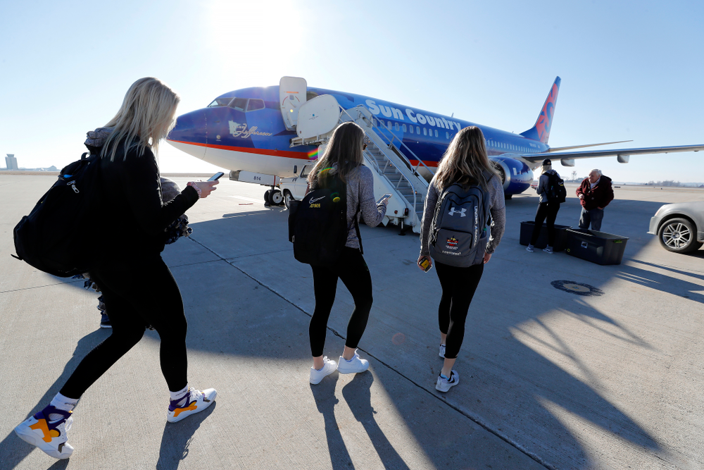 Iowa Hawkeyes guard Makenzie Meyer (3), guard Kathleen Doyle (22), and forward Hannah Stewart (21) walk to the team's plane as they travel to Los Angeles for the first round of the 2018 NCAA Tournament Thursday, March 15, 2018 at the Eastern Iowa Airport. (Brian Ray/hawkeyesports.com)