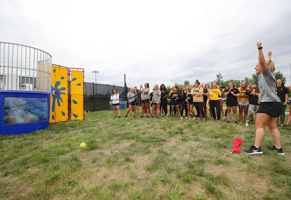 Iowa Field Hockey's Ryley Miller sinks assistant strength and conditioning coach Ashley Renteria in the dunk tank during the Student-Athlete Kickoff outside the Karro Athletics Hall of Fame Building in Iowa City on Sunday, Aug 25, 2019. (Stephen Mally/hawkeyesports.com)