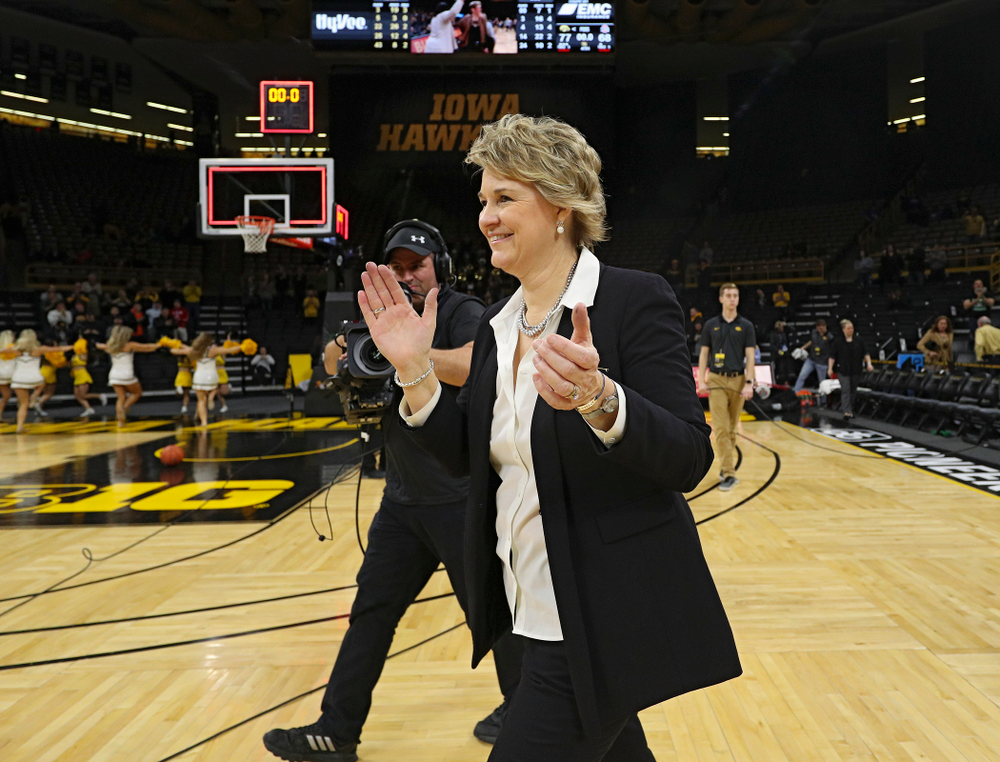 Iowa Hawkeyes head coach Lisa Bluder claps as she walks to the center of the court after winning their game at Carver-Hawkeye Arena in Iowa City on Thursday, January 23, 2020. (Stephen Mally/hawkeyesports.com)