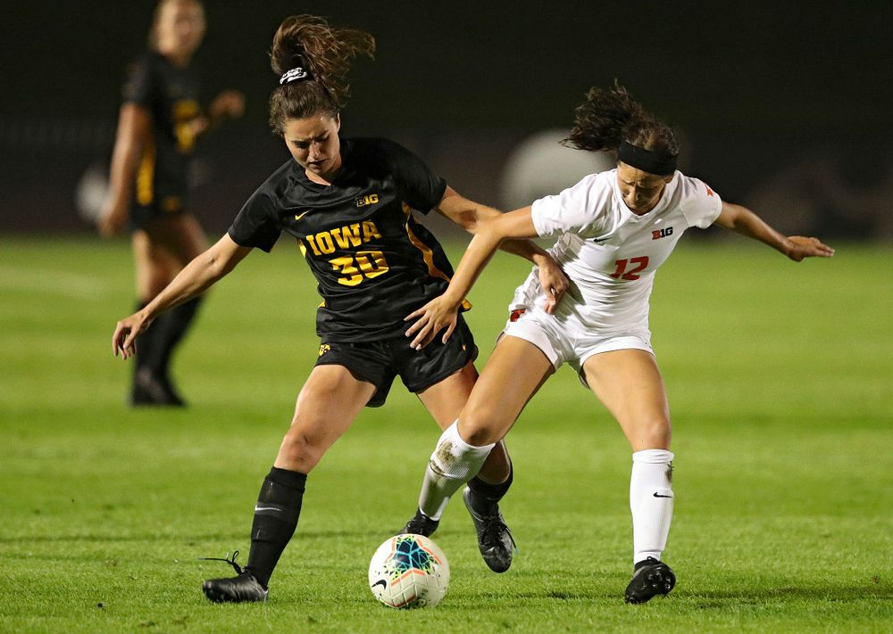 Iowa forward Devin Burns (30) battles for position on the ball during the second half of their match against Illinois at the Iowa Soccer Complex in Iowa City on Thursday, Sep 26, 2019. (Stephen Mally/hawkeyesports.com)