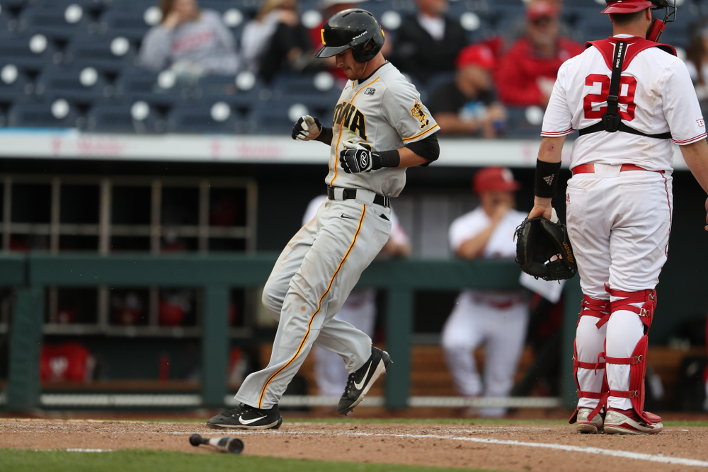 Iowa Hawkeyes Tanner Wetrich (16) scores against the Indiana Hoosiers in the first round of the Big Ten Baseball Tournament Wednesday, May 22, 2019 at TD Ameritrade Park in Omaha, Neb. (Brian Ray/hawkeyesports.com)