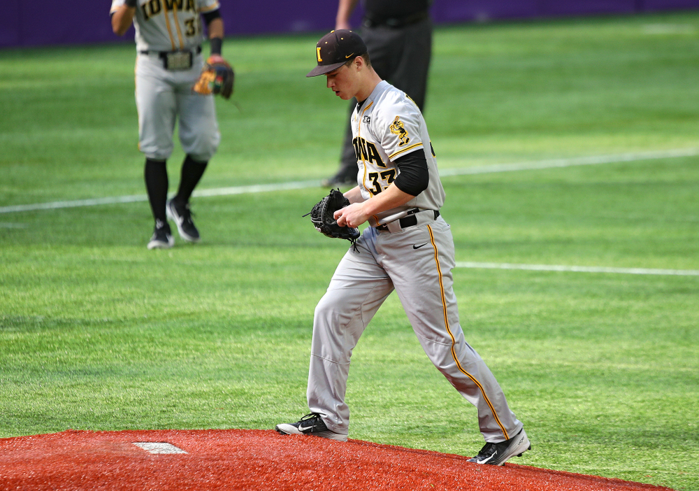 Iowa Hawkeyes pitcher Jack Dreyer (33) walks up the mound during the fourth inning of their CambriaCollegeClassic game at U.S. Bank Stadium in Minneapolis, Minn. on Friday, February 28, 2020. (Stephen Mally/hawkeyesports.com)