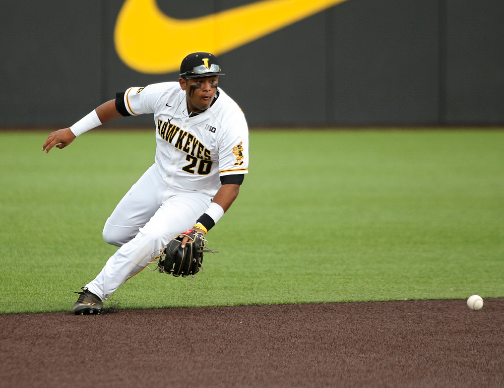 Iowa infielder Izaya Fullard (20) fields a ground ball during the seventh inning of their college baseball game at Duane Banks Field in Iowa City on Wednesday, March 11, 2020. (Stephen Mally/hawkeyesports.com)