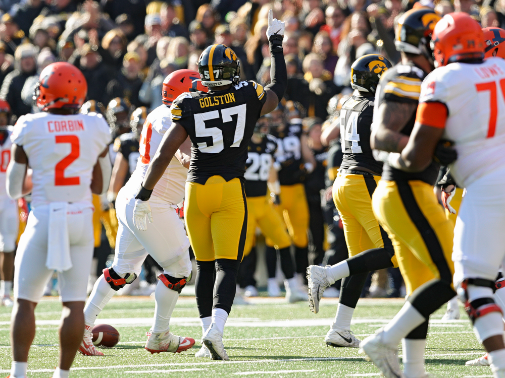 Iowa Hawkeyes defensive end Chauncey Golston (57) celebrates after knocking down a pass during the second quarter of their game at Kinnick Stadium in Iowa City on Saturday, Nov 23, 2019. (Stephen Mally/hawkeyesports.com)