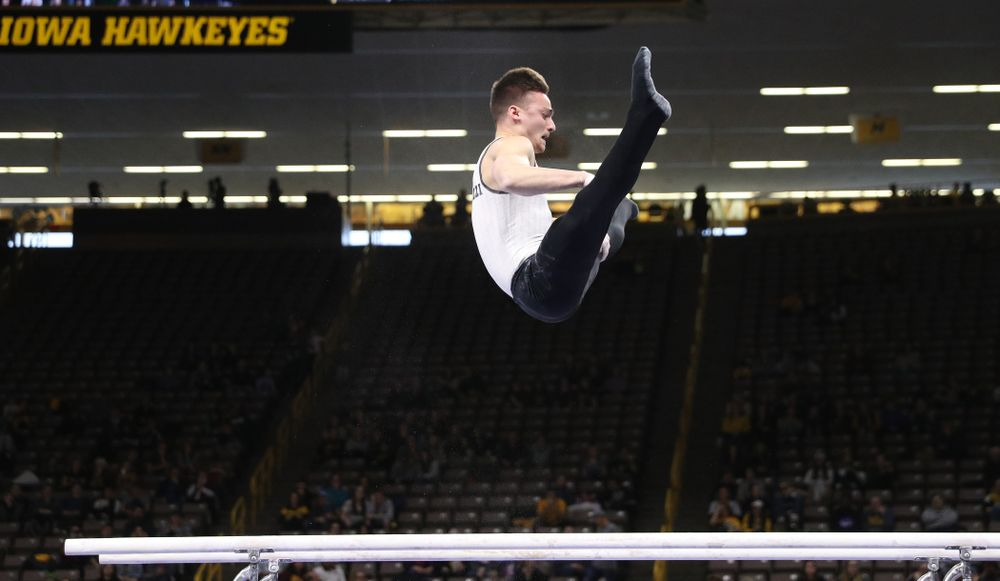 Iowa's Mitch Mandozzi competes on the parallel bars against UIC and Minnesota Saturday, February 2, 2019 at Carver-Hawkeye Arena. (Brian Ray/hawkeyesports.com)