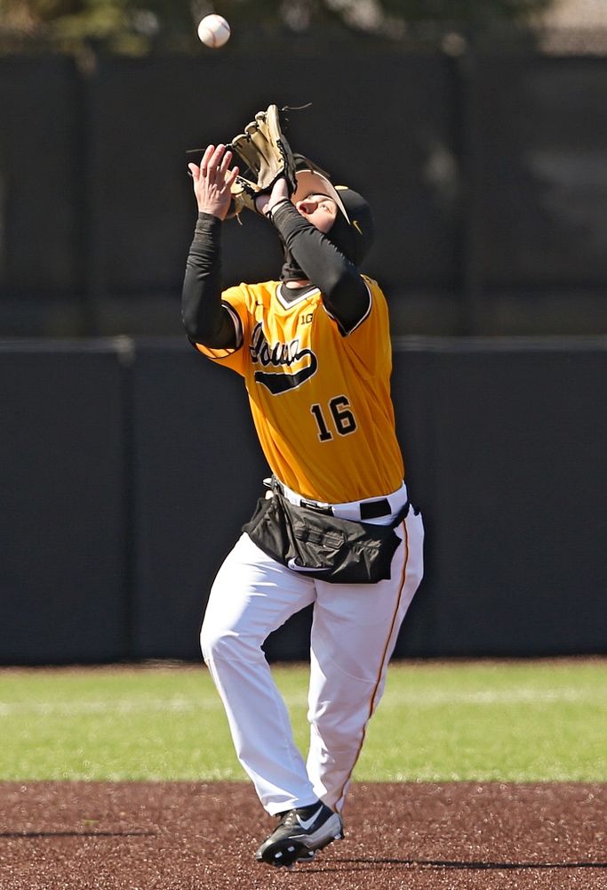 Iowa Hawkeyes shortstop Tanner Wetrich (16) fields a pop up for an out during the sixth inning against Illinois at Duane Banks Field in Iowa City on Sunday, Mar. 31, 2019. (Stephen Mally/hawkeyesports.com)