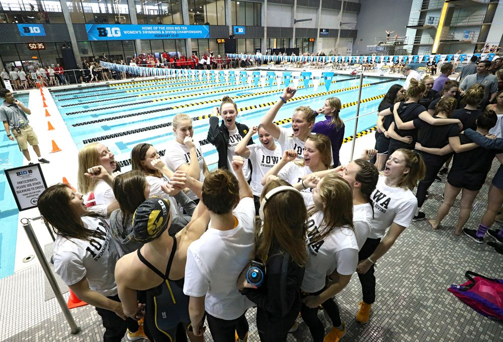 The Hawkeyes huddle during the 2020 Big Ten Women's Swimming and Diving Championships at the Campus Recreation and Wellness Center in Iowa City on Wednesday, February 19, 2020. (Stephen Mally/hawkeyesports.com)