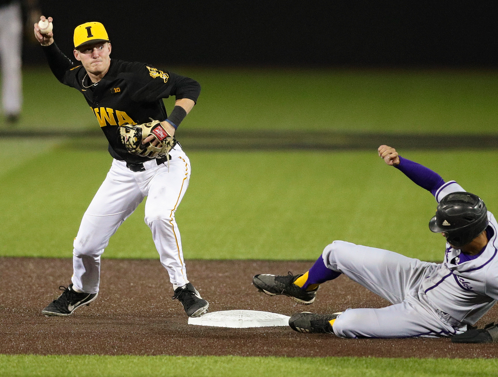 Iowa Hawkeyes second baseman Brendan Sher (2) throws to first base as they turn a double play during the seventh inning of their game against Western Illinois at Duane Banks Field in Iowa City on Wednesday, May. 1, 2019. (Stephen Mally/hawkeyesports.com)