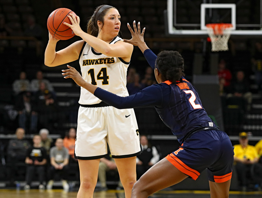Iowa Hawkeyes guard Mckenna Warnock (14) looks to pass during the second quarter of their game at Carver-Hawkeye Arena in Iowa City on Tuesday, December 31, 2019. (Stephen Mally/hawkeyesports.com)