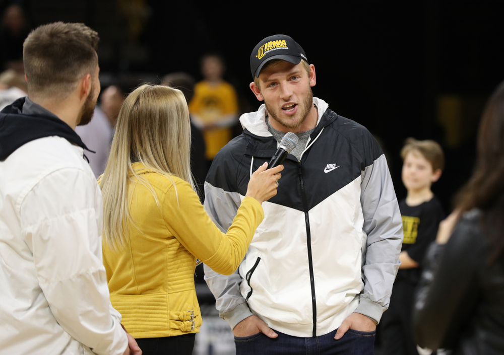 The Hawkeye Football team is introduced during a timeout of the Iowa Hawkeyes game against the Michigan Wolverines Friday, February 1, 2019 at Carver-Hawkeye Arena. (Brian Ray/hawkeyesports.com)