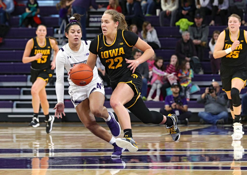 Iowa Hawkeyes guard Kathleen Doyle (22) drives down the court with the ball during the third quarter of their game at Welsh-Ryan Arena in Evanston, Ill. on Sunday, January 5, 2020. (Stephen Mally/hawkeyesports.com)
