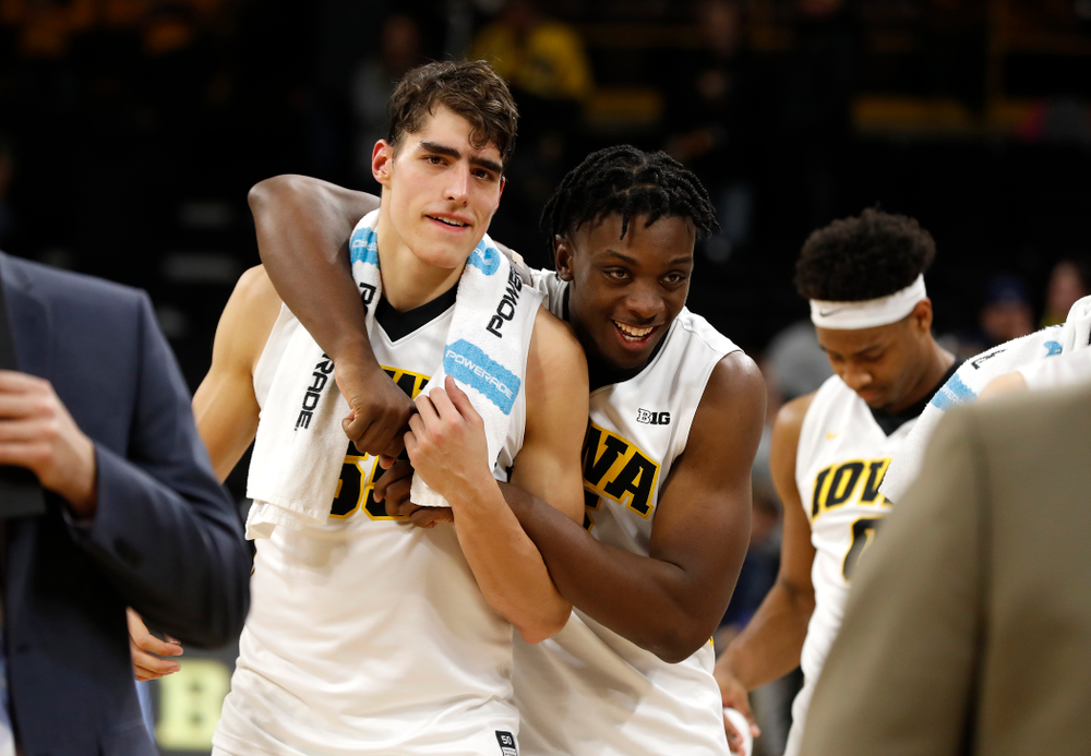 Iowa Hawkeyes forward Luka Garza (55) and forward Tyler Cook (5)