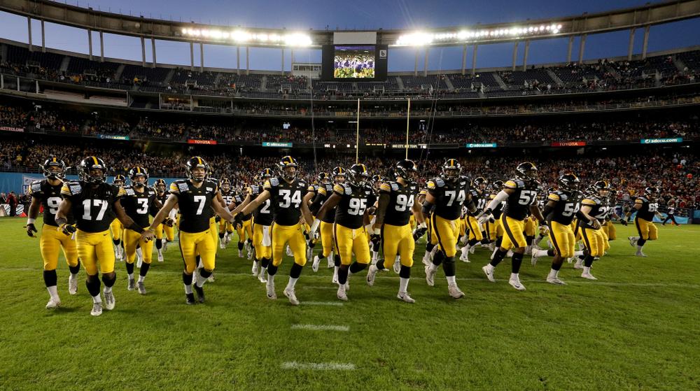 The Iowa Hawkeyes swarm onto the field against USC in the Holiday Bowl Friday, December 27, 2019 at San Diego Community Credit Union Stadium.  (Brian Ray/hawkeyesports.com)