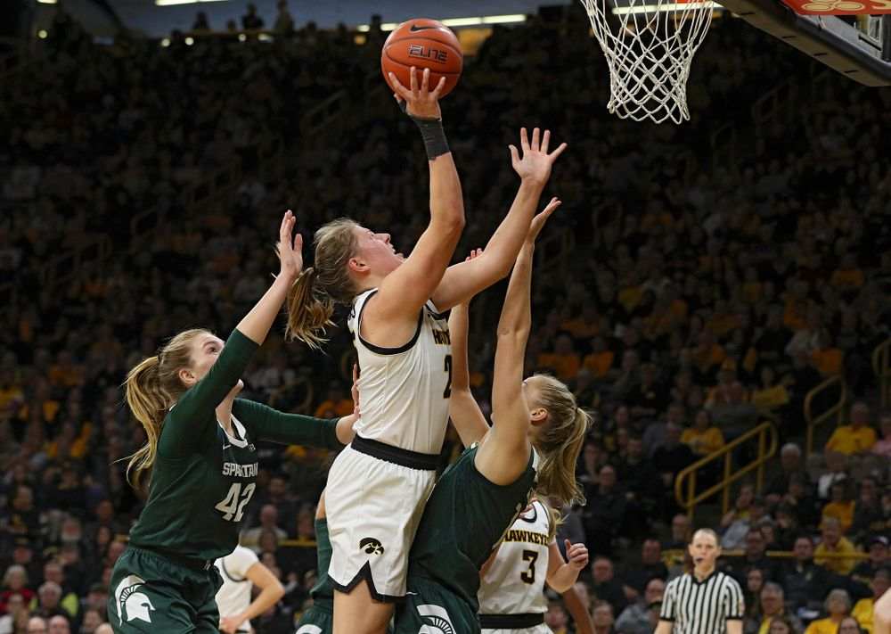 Iowa Hawkeyes forward Monika Czinano (25) makes a basket during the third quarter of their game at Carver-Hawkeye Arena in Iowa City on Sunday, January 26, 2020. (Stephen Mally/hawkeyesports.com)