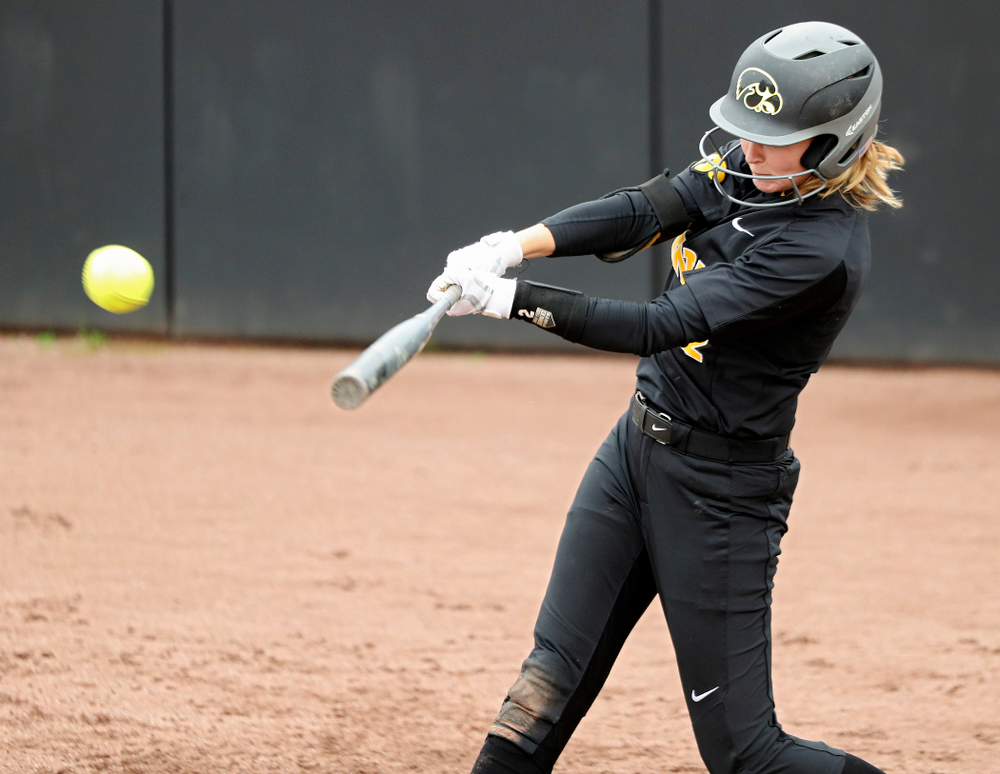 Iowa's Aralee Bogar (2) drives in two runs with a hit during the fourth inning of their game against Iowa Softball vs Indian Hills Community College at Pearl Field in Iowa City on Sunday, Oct 6, 2019. (Stephen Mally/hawkeyesports.com)