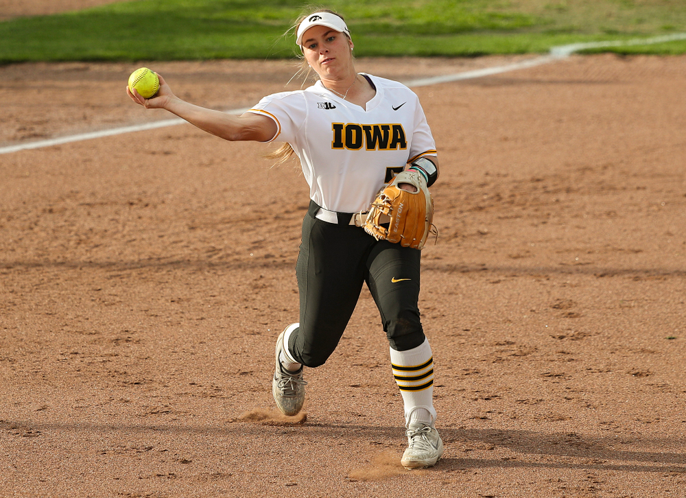 Iowa third baseman Sydney Owens (5) throws to first for an out during the third inning of their game against Ohio State at Pearl Field in Iowa City on Friday, May. 3, 2019. (Stephen Mally/hawkeyesports.com)
