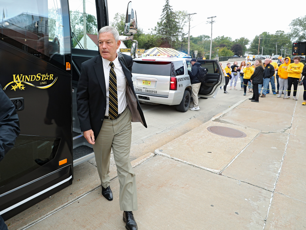 Iowa Hawkeyes head coach Kirk Ferentz steps off the bus as he arrives with his team before their game at Kinnick Stadium in Iowa City on Saturday, Sep 28, 2019. (Stephen Mally/hawkeyesports.com)