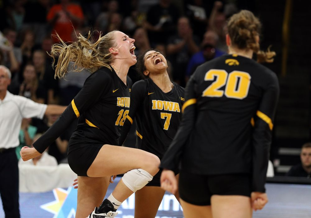 Iowa Hawkeyes middle blocker Hannah Clayton (18) and setter Brie Orr (7) celebrate a point against the Iowa State Cyclones Saturday, September 21, 2019 during the Iowa Corn Cy-Hawk Series Tournament at Carver-Hawkeye Arena. (Brian Ray/hawkeyesports.com)