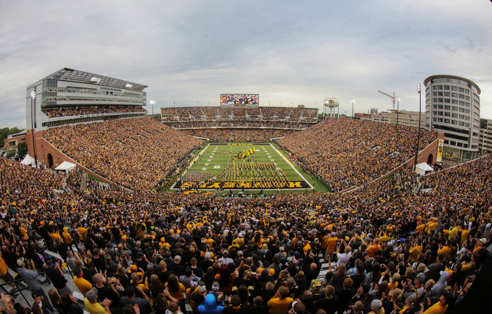 The Iowa Hawkeyes swarm onto the field for their game against the Miami RedHawks Saturday, August 31, 2019 at Kinnick Stadium in Iowa City. (Brian Ray/hawkeyesports.com)