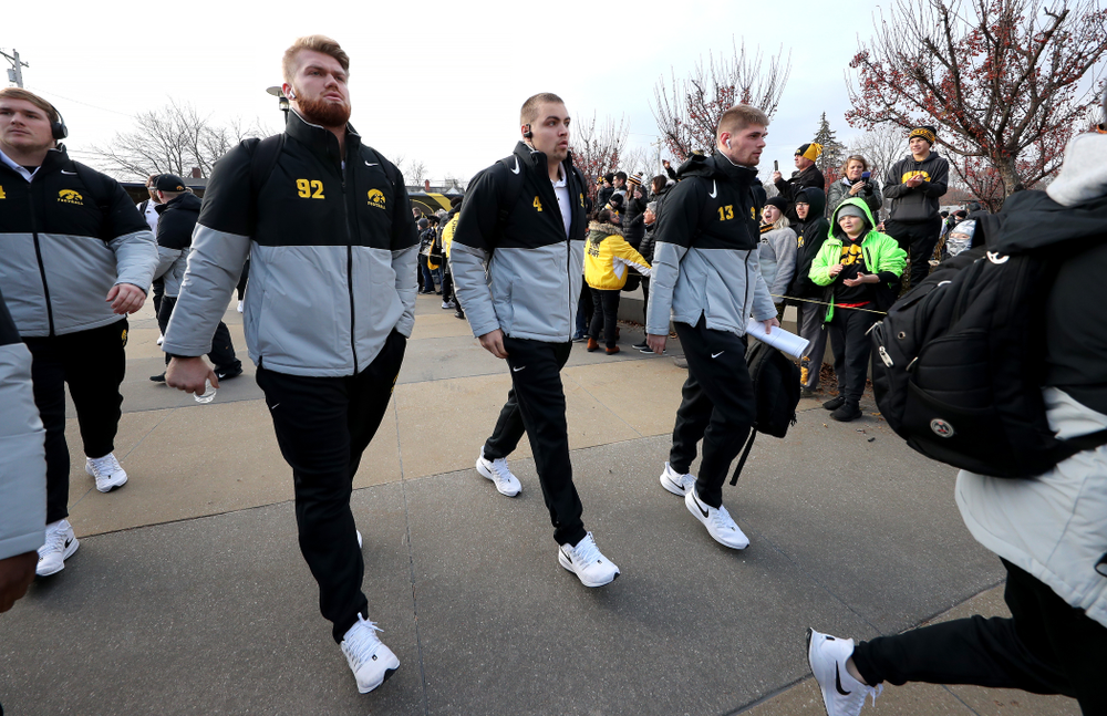 Iowa Hawkeyes quarterback Nate Stanley (4), defensive lineman John Waggoner (92), and wide receiver Henry Marchese (13) against the Illinois Fighting Illini Saturday, November 23, 2019 at Kinnick Stadium. (Brian Ray/hawkeyesports.com)