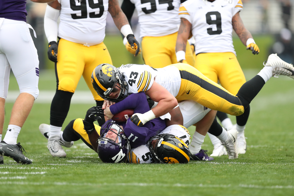 Iowa Hawkeyes linebacker Dillon Doyle (43) and defensive end Chauncey Golston (57) against the Northwestern Wildcats Saturday, September 28, 2019 at Kinnick Stadium. (Max Allen/hawkeyesports.com)