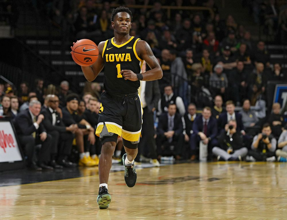 Iowa Hawkeyes guard Joe Toussaint (1) brings the ball down the court during the first half of their game at Carver-Hawkeye Arena in Iowa City on Monday, January 27, 2020. (Stephen Mally/hawkeyesports.com)