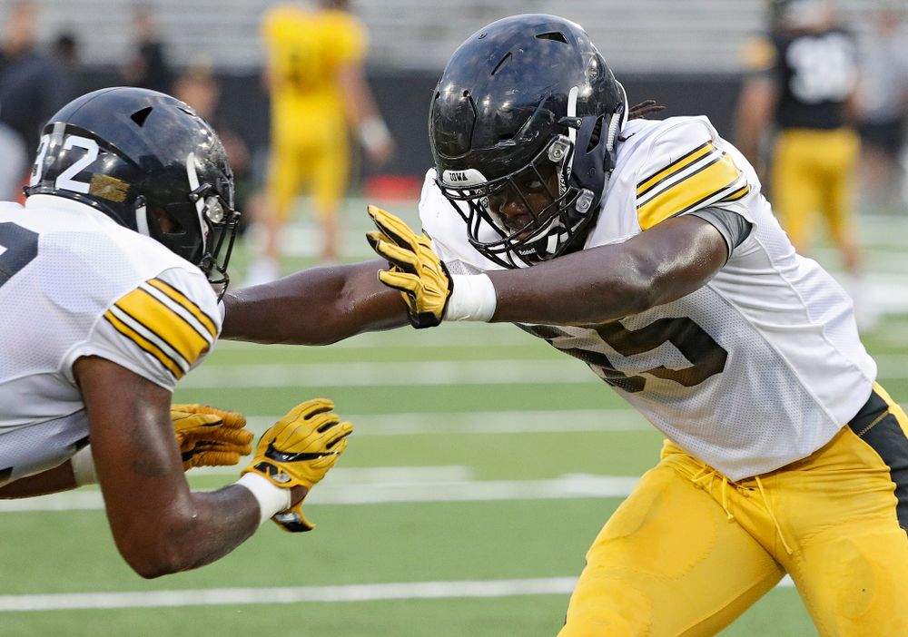 Iowa Hawkeyes linebacker Yahweh Jeudy (55) eyes linebacker Djimon Colbert (32) as they run a drill during Fall Camp Practice No. 12 at Kinnick Stadium in Iowa City on Thursday, Aug 15, 2019. (Stephen Mally/hawkeyesports.com)