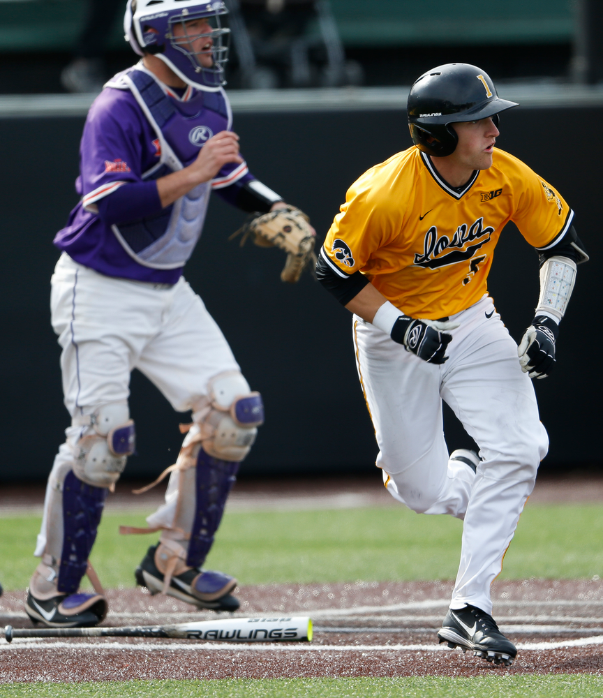 Iowa Hawkeyes catcher Tyler Cropley (5) runs to first base during a game against Evansville at Duane Banks Field on March 18, 2018. (Tork Mason/hawkeyesports.com)