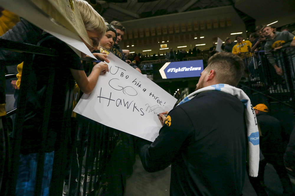 Iowa Hawkeyes guard Jordan Bohannon (3) signs an autograph for a fan during Iowa men's basketball vs SIUE on Friday, November 8, 2019 at Carver-Hawkeye Arena. (Lily Smith/hawkeyesports.com)