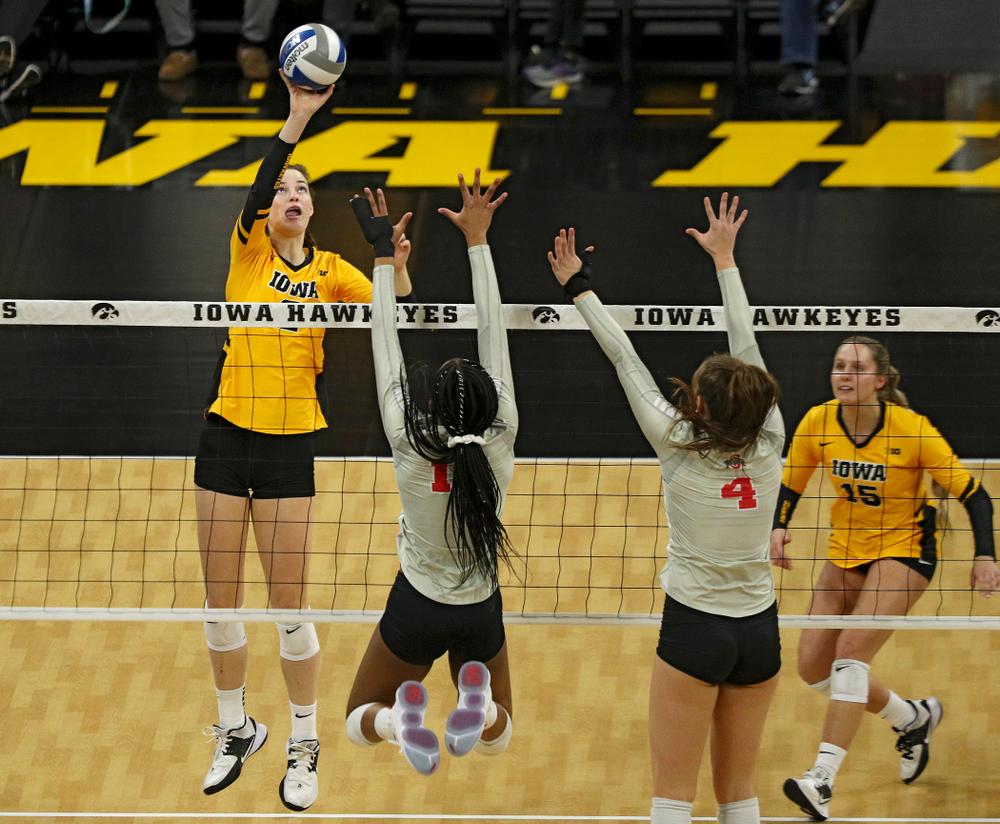 Iowa's Courtney Buzzerio (2) tips the ball over the net during the second set of their match at Carver-Hawkeye Arena in Iowa City on Friday, Nov 29, 2019. (Stephen Mally/hawkeyesports.com)