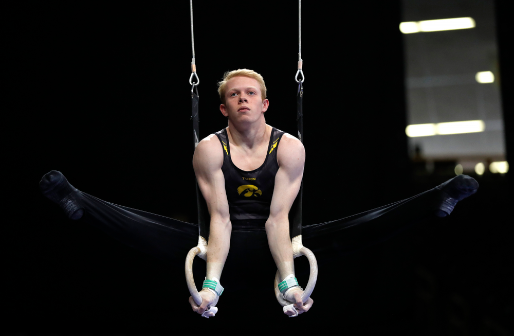 Nick Merryman competes on the rings against Illinois