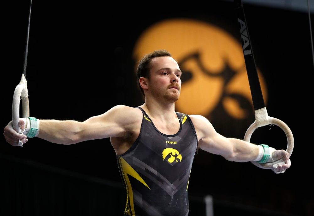 Dylan Ellsworth competes on the rings against Minnesota and Air Force