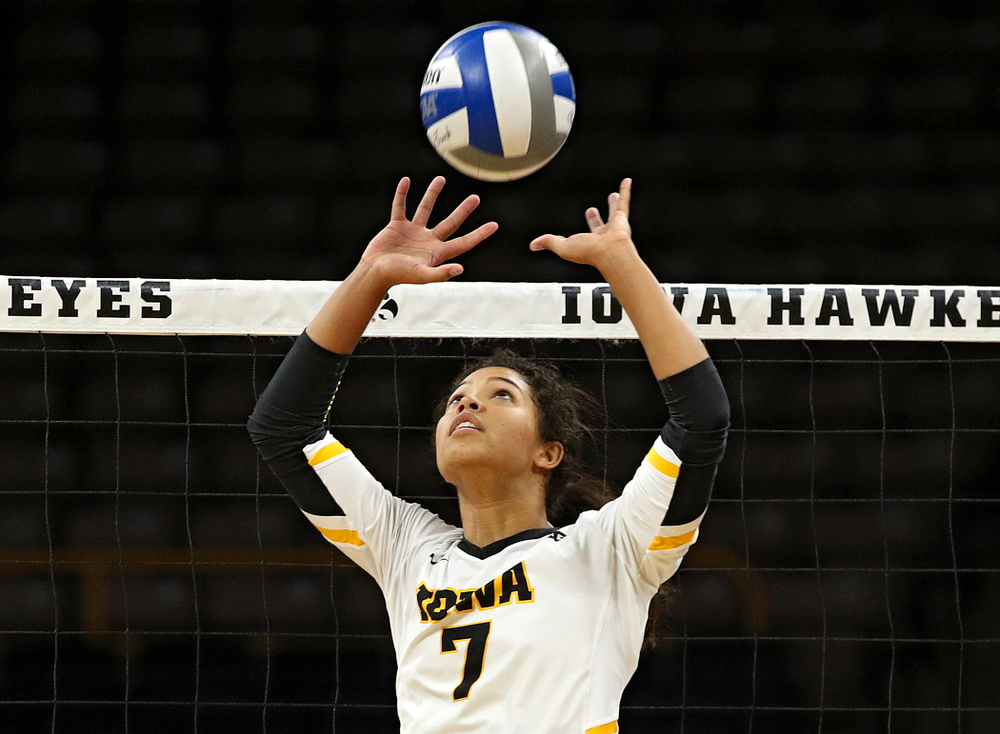 Iowa's Brie Orr (7) sets the ball during the second set of their volleyball match at Carver-Hawkeye Arena in Iowa City on Sunday, Oct 13, 2019. (Stephen Mally/hawkeyesports.com)