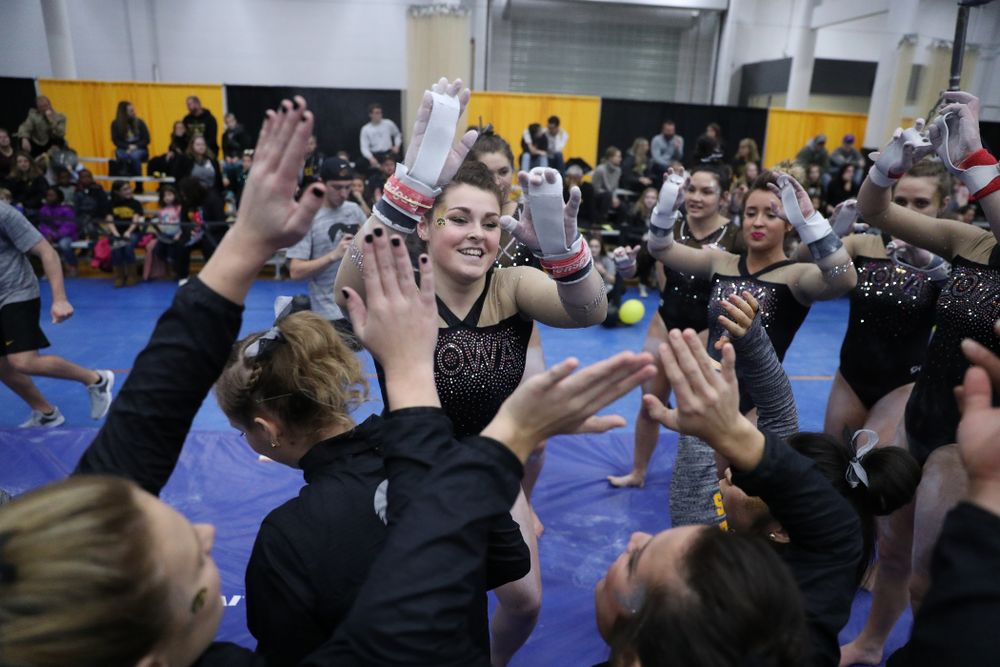 Erin Castle competes on the bars during the Black and Gold intrasquad meet Saturday, December 1, 2018 at the University of Iowa Field House. (Brian Ray/hawkeyesports.com)