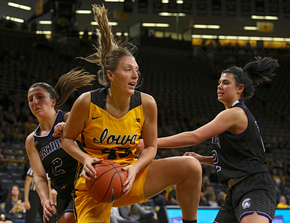 Iowa forward Amanda Ollinger (43) pulls down a rebound during the third quarter of their game against Winona State at Carver-Hawkeye Arena in Iowa City on Sunday, Nov 3, 2019. (Stephen Mally/hawkeyesports.com)