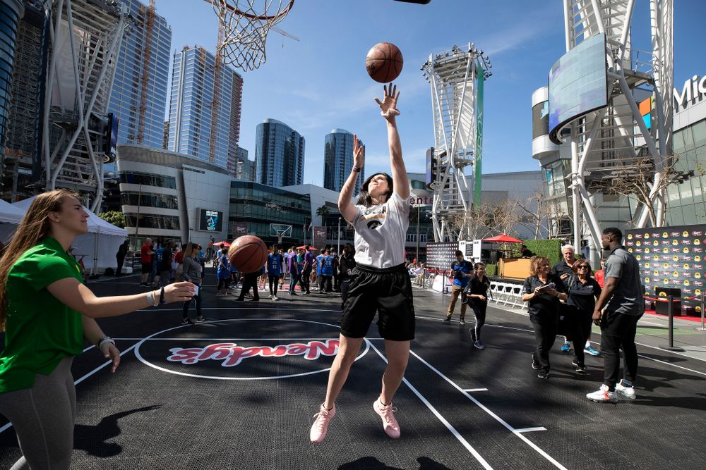 Iowa Hawkeyes forward Megan Gustafson (10) shoots baskets with OregonÕs Sabrina Ionescu before a Special Olympics event Friday, April 12, 2019 as part of the ESPN College Basketball Awards in the XBOX Plaza at LA Live.  (Brian Ray/hawkeyesports.com)