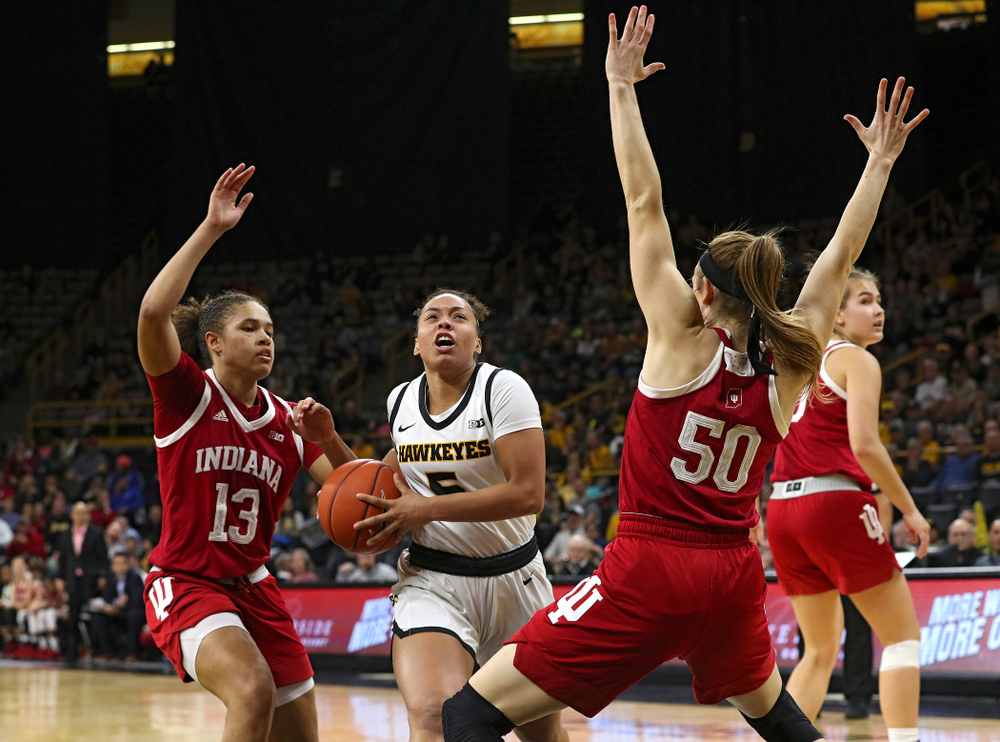 Iowa Hawkeyes guard Alexis Sevillian (5) drives in before being fouled during the second overtime period of their game at Carver-Hawkeye Arena in Iowa City on Sunday, January 12, 2020. (Stephen Mally/hawkeyesports.com)