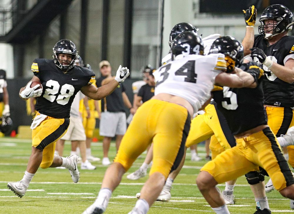 Iowa Hawkeyes running back Toren Young (28) on a run during Fall Camp Practice No. 6 at the Hansen Football Performance Center in Iowa City on Thursday, Aug 8, 2019. (Stephen Mally/hawkeyesports.com)