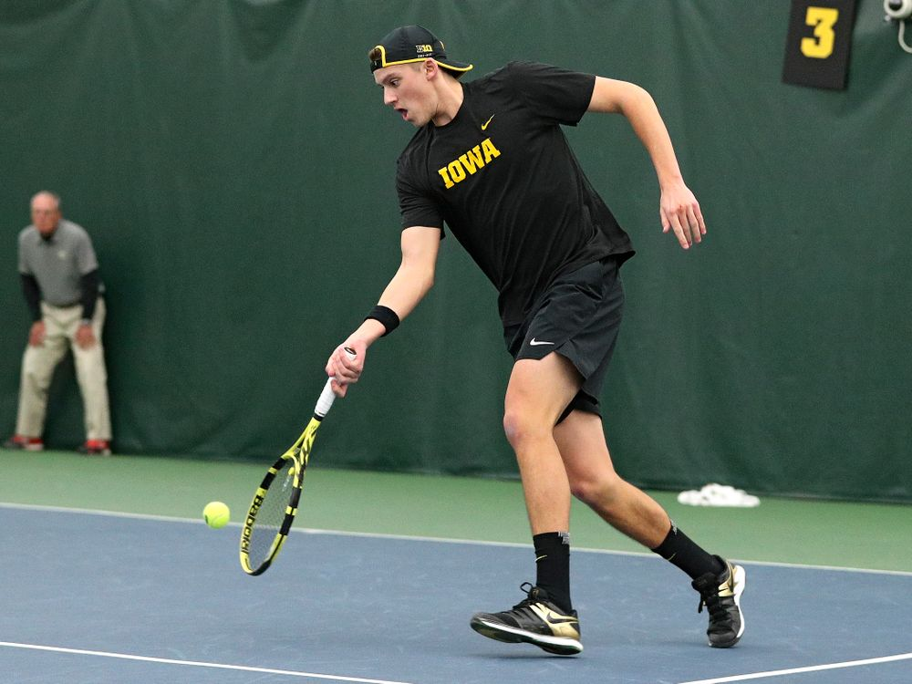 Iowa's Joe Tyler returns a shot during his doubles match at the Hawkeye Tennis and Recreation Complex in Iowa City on Friday, February 14, 2020. (Stephen Mally/hawkeyesports.com)