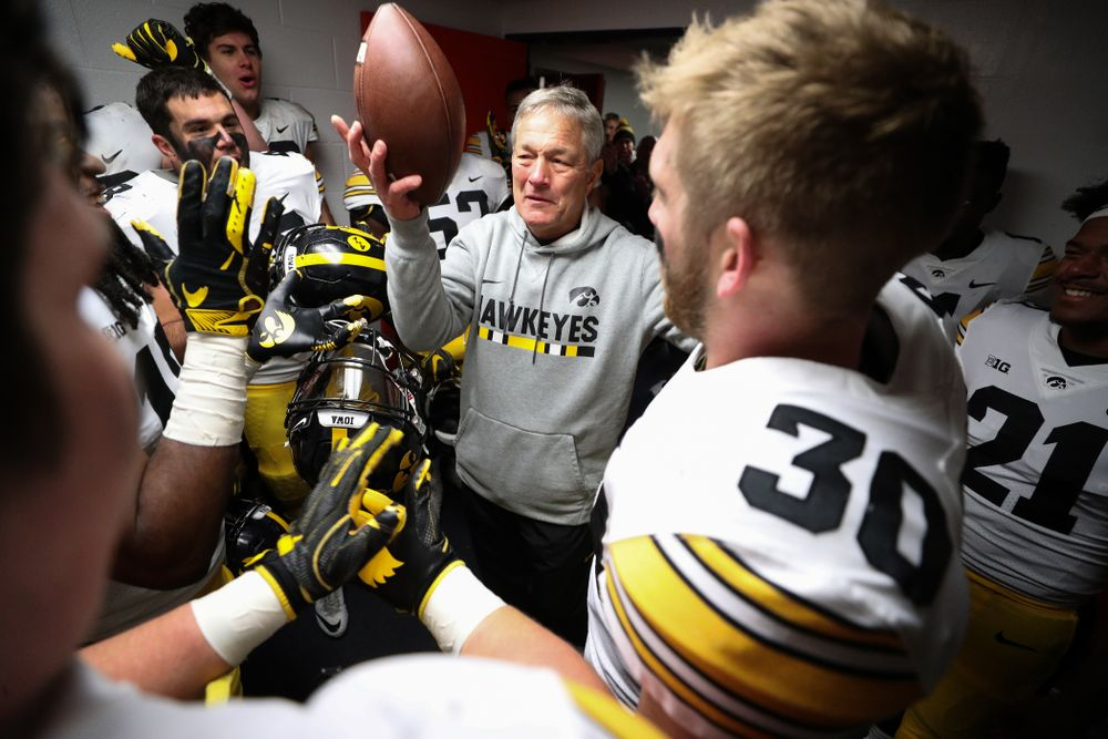 Iowa Hawkeyes defensive back Jake Gervase (30) presents the game ball to head coach Kirk Ferentz to commemorate his 150th win as head coach fo the Iowa Hawkeyes following their 63-0 win over the Illinois Fighting Illini Saturday, November 17, 2018 at Memorial Stadium in Champaign, Ill. (Brian Ray/hawkeyesports.com)