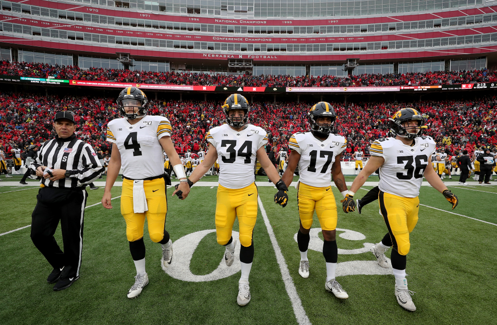 Iowa Hawkeyes captains quarterback Nate Stanley (4), linebacker Kristian Welch (34), defensive back Devonte Young (17), and fullback Brady Ross (36) against the Nebraska Cornhuskers Friday, November 29, 2019 at Memorial Stadium in Lincoln, Neb. (Brian Ray/hawkeyesports.com)