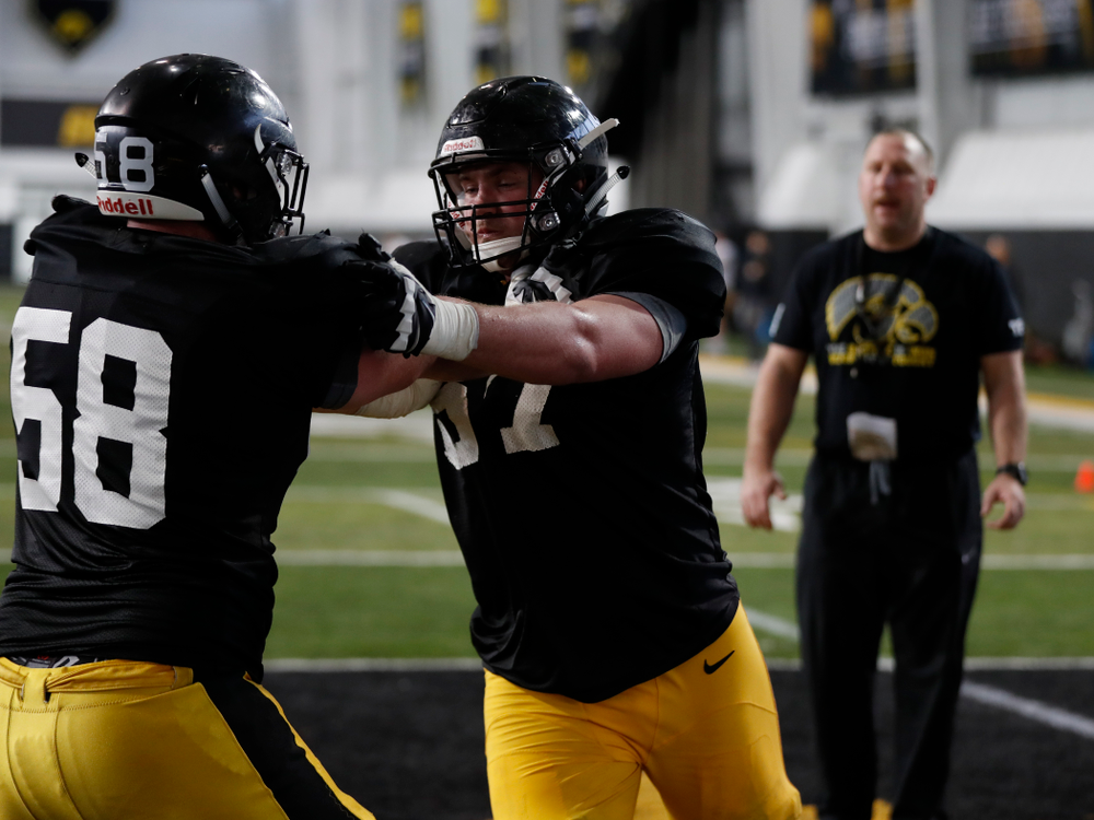 Iowa Hawkeyes offensive lineman Jake Newborg (58) and offensive lineman Levi Duwa (67) during spring practice  Thursday, March 29, 2018 at the Hansen Football Performance Center. (Brian Ray/hawkeyesports.com)