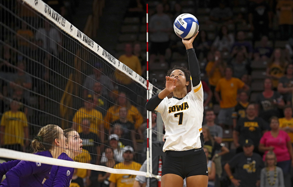 Iowa's Brie Orr (7) tips the ball over the net during their Big Ten/Pac-12 Challenge match at Carver-Hawkeye Arena in Iowa City on Saturday, Sep 7, 2019. (Stephen Mally/hawkeyesports.com)