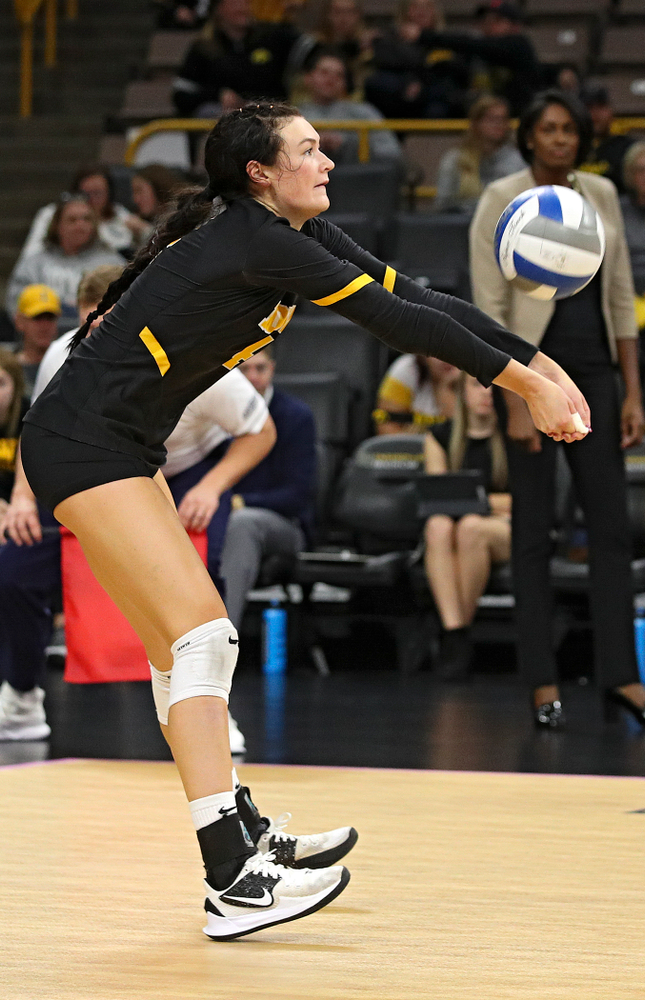 Iowa's Halle Johnston (4) gets a dig during the second set of their volleyball match at Carver-Hawkeye Arena in Iowa City on Sunday, Oct 13, 2019. (Stephen Mally/hawkeyesports.com)