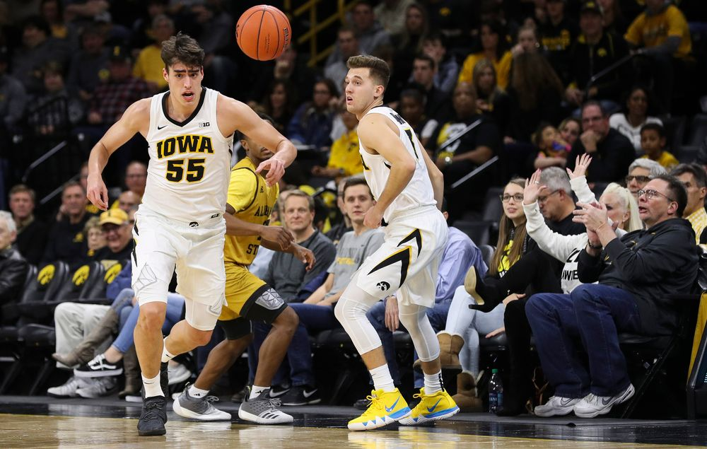 Iowa Hawkeyes forward Luka Garza (55) chases down a loose ball during a game against Alabama State at Carver-Hawkeye Arena on November 21, 2018. (Tork Mason/hawkeyesports.com)